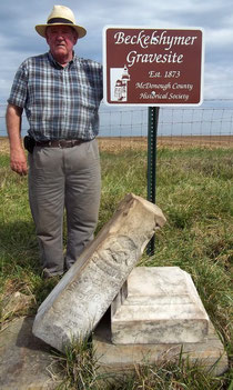 Dave Ruebush accepts a new sign marking the grave of Sarah Beckelshymer which is located on his property in Sciota Township.
