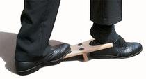 Schuhe mit Stiefelknecht ausziehen