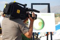 In foto un cameraman RAI durante l'evento con opere di E.Martorana