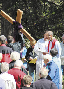 The Reverend Jerry Blake facilitated the service and recited prayers at each station, while guests took turns carrying the large wooden cross.