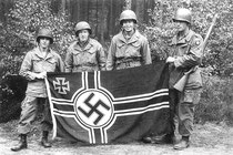 "Chris Reistroffer (at far left) is pictured here with fellow soldiers on his 19th birthday. He ""liberated"" the Nazi flag while behind enemy lines."