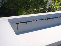 Failure of metal parapet under-flashing