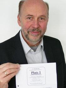 Augenoptikermeister Jens-Henning Gloyer freut sich über die Auszeichnung und dankt seinen Kunden für die Unterstützung.
