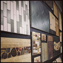 Wall of display boards with examples of tile layouts and designs