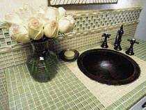 Green and white glass mosaics on a bathroom vanity and backsplash. We have thousands of glass options,
