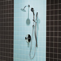 Blue and dark brown ceramic wall tiles in a shower