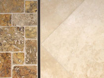 Scabos unfilled and tumbled travertine Versailles mosaic with ivory filled and honed travertine tiles and a Tuscan bronze Schluter Quadec trim