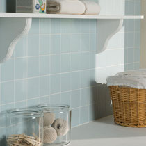 Light blue ceramic tile on a laundry room wall