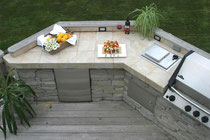 A Tiled Countertop In An Outdoors Patio Kitchen