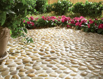 Yellow pebble patio in a garden
