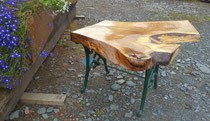 Garden table in solid Oak with cast iron stands