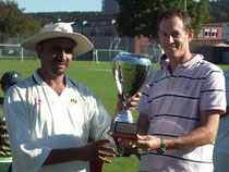 Power CC captain S.Safiat receives the Pickwick Cup Trophy from Jon Southworth