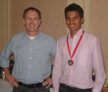 U15 coach Patrick Henderson and Bob Barber award winner Ashwin Vinod