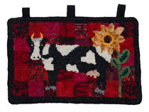 rug hooked black and white cow with sun flower on red and black background