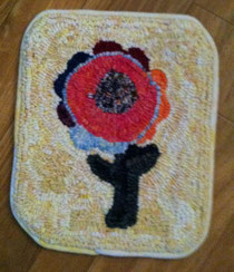 Katie's little mat for a footstool.