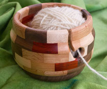 Handmade wood pieced and turned yarn bowl.