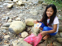 Reydenn Grace participating in coastal and river cleanup activity in their area
