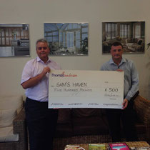 Paul receiving cheque for £500 from Thomas Sanderson's Managing Director Nigel Campkin