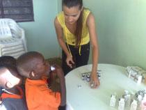 Project Coordinator, Stella Bili giving medicine to the children
