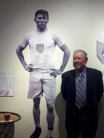 Bill Thorpe with an image of his father Jim Thorpe