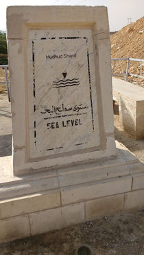 There are numerous signs/monuments at the dead sea to remind you that you're below sea level. Dante Harker