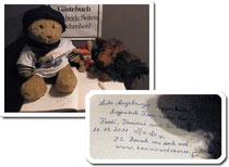 Kasimir, Cäsar und Fredi tragen sich in das Gästebuch der Augsburger Puppenkiste ein