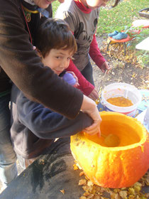 Elijah helping with the pumpkin