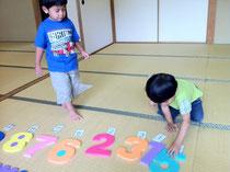 Children arranged numbers