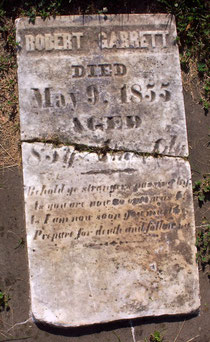 Headstone for Robert Garrett, who sold his land to the county for the cemetery, with an inscription carved by John Long.