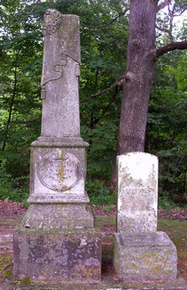 The family headstone (left) and government marker for Roswell Tyrrell, veteran of the War of 1812 and considered the first settler in Tennessee Township.