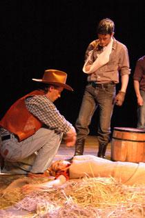 Slim (Ian Martin) examines Curley's dead wife (Linden Wint)