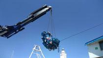Rimini gru sollevamento e trasporto motore barca presso porto di Rimini