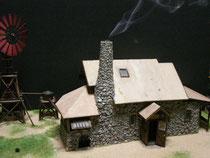 製作途中の石の家の煙突発煙装置