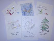子どもたちが描いてくれた、これまでのクリスマス・コンサートのプログラムの表紙(一部)