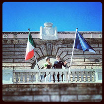 Man & wife from the balcony of the Comune overlooking Piazza Risorgimento.