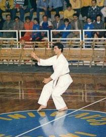 Sensei performing kata Bassai Sho in competition.