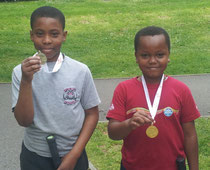 Deji and Max with their medals