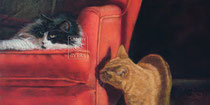 Zwei-Katzen-auf-dem-roten-Sessel