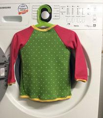 Hinten Pullover, vorne Strickjacke