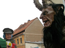 A child's reaction to a mask in a festival parade, Ptuj, Slovenia, 2008. Nicole Harper©