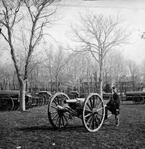 Mathew Brady, Union soldier by gun at US Arsenal, Washington DC, 1862, USA Library of Congress