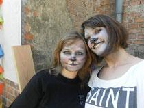 """Zwei Mitlgieder von """"Zukunft Wolf"""" als Wölfe geschminkt"""