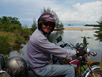 Easy Rider Uncle Nine driving his motorbike on the Phu Quoc Island in Vietnam
