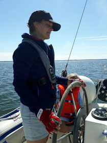 Lovisa at the helm sailing