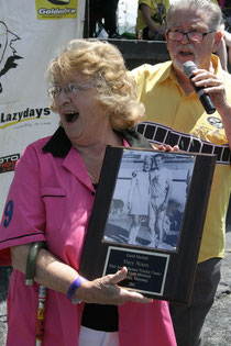 Mary Nixon, receiving a plaque from Richard Riley