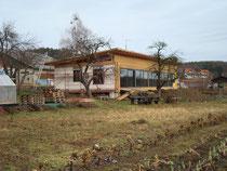 Einfamilienhaus aus Stroh, Holz und Lehm