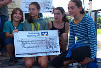 Scheckübergabe vom 24 Stunden-Lauf am Weltkindertag im Seepark