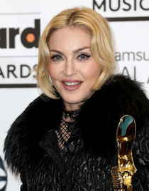 http://www.aceshowbiz.com/images/wennpic/madonna-2013-billboard-music-awards-press-room-07.jpg