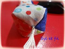 Coussin bouillotte repose poignet bleu et orange