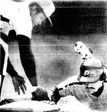 Larry Bowa beats a pickoff attempt as Ellis Valentine applies the tag.